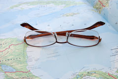 Eye glasses on map Stock Photos