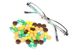 Eye glasses and medicine Royalty Free Stock Photos