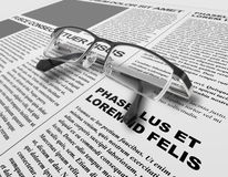 Eye glasses and newspaper Stock Photos