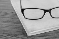 Eye glasses on note book black and white Royalty Free Stock Image