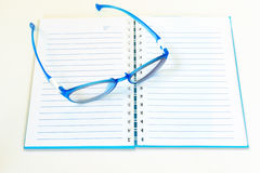 Eye glasses on notebook Royalty Free Stock Photography
