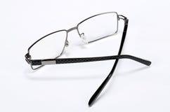 Eye glasses. Pair of black metal modern eye glasses stock photos