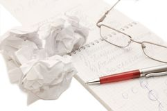Eye glasses and a pen on sheet Stock Image