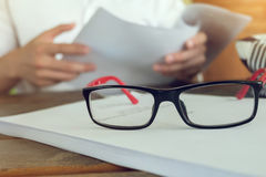Eye glasses placed on a blank paper Stock Images