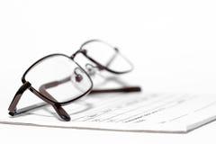 Eye glasses on prescription pad Royalty Free Stock Photo