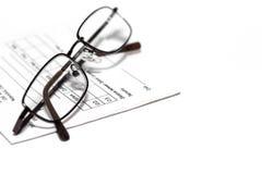 Eye glasses on prescription pad Stock Photo