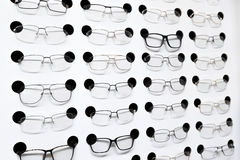 Eye glasses on the shelf in shop Stock Photos