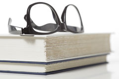 eye glasses on stack of books Stock Photo