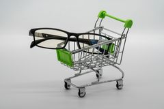 Eye glasses or Eye-Wear with shopping cart on white. Background stock images
