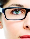 Eye in glasses. Woman's green eye in glasses close up royalty free stock photos