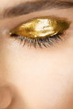 Eye with golden make-up Royalty Free Stock Photo