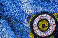 Eye graffiti. A graffiti painting of an eyeball on a blue background Royalty Free Stock Images