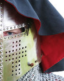 Eye in great helm. Knights eye looking from visor slit in great helm royalty free stock photography