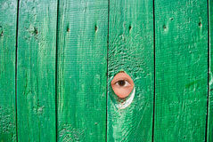 Eye in a hole in fence Royalty Free Stock Photos