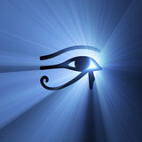 Eye of Horus Egyptian symbol light flare. Eye of Horus (wadjet or Eye of Ra) in ancient Egypt as sign of healing and protection, with mysterious blue light flare Stock Photo