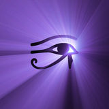 Eye of Horus Egyptian symbol light flare. Eye of Horus (wadjet or Eye of Ra) in ancient Egypt as symbol of healing and protection with powerful purple light halo Royalty Free Stock Photo
