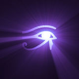 Eye of Horus Egyptian symbol light flare. Eye of Horus (wadjet or Eye of Ra) in ancient Egypt as symbol of healing and protection with powerful purple light halo Royalty Free Stock Images