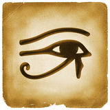 Eye of Horus symbol old paper. Eye of Horus (wadjet or Eye of Ra) in ancient Egypt as sign of healing and protection marked on weathered papyrus Royalty Free Stock Photography