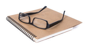 Eye i vetri vetri dell'occhio con il libro sui precedenti Immagini Stock Libere da Diritti