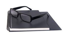 Eye i vetri vetri dell'occhio con il libro sui precedenti Immagine Stock Libera da Diritti