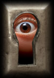 Eye In Keyhole Stock Images
