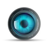 Eye inside the camera lens Royalty Free Stock Image