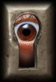 Eye in keyhole. Curiosity eye in keyhole - spy concept Royalty Free Stock Image