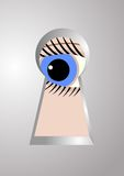The eye in the keyhole. Royalty Free Stock Photo