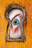 Eye in  keyhole Royalty Free Stock Photography
