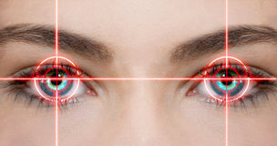 Eye laser. Konzept photo of eyes with red laser beam Royalty Free Stock Images