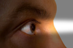 Eye and light beam. Human eye and light beam Stock Photo