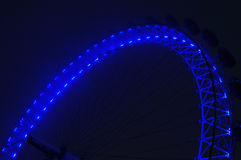 Eye of london. Spinning London Eye close detail at night with blue lights Stock Photos
