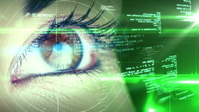 Eye looking at futuristic interface showing text stock footage