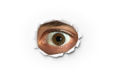 Eye Looking Through a Hole Royalty Free Stock Photos