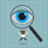 Eye looking through a magnifying glass finding man Royalty Free Stock Photography
