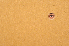 Eye looking through a wall Stock Image