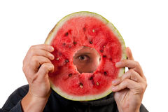 Eye looking through watermelon slice Royalty Free Stock Images