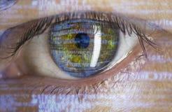 Eye macro with software code. Overlay Stock Photo