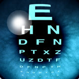 Eye Macro Vision. And eyesight for healthy eyes with good ocular focus using an eye chart to help focus for near sighted and far sighted retina and lense Royalty Free Stock Photography