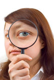 Eye and magnifying glass Stock Photos