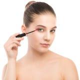 Eye make up apply. Mascara applying closeup, long lashes. makeup brush. Isolated. Royalty Free Stock Images