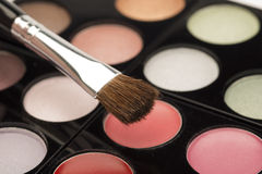 Eye make up with brush. Beautiful pink, green and beige eye make up selection palette with a brush stock photography