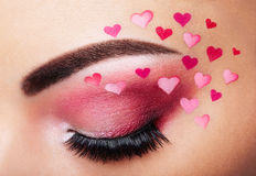 Eye make-up girl with a heart Royalty Free Stock Photos