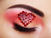 Eye make-up girl with a heart Stock Images