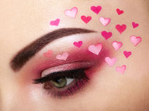 Eye make-up girl with a heart Stock Photo