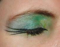 Eye makeup. Gothic style eye makeup in green and black Royalty Free Stock Photography