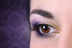 Eye makeup. Beautiful violet eye makeup on blurred background Stock Images