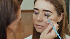 Eye Makeup. Beautiful Eyes Glitter Make-up. Holiday Makeup detail. Eyelids of the eyes. stock footage