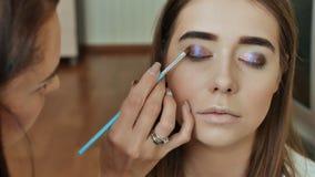 Eye Makeup. Beautiful Eyes Glitter Make-up. Holiday Makeup detail. Eyelids of the eyes. stock video footage