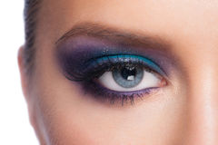 Eye makeup. Closeup of beautiful woman eye with bright fancy colorful makeup Royalty Free Stock Photo
